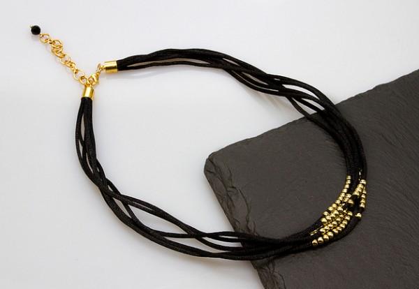 Satincollier | schwarz-gold, mehrreihig